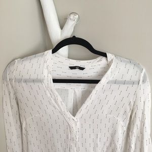 White blouse with arrows